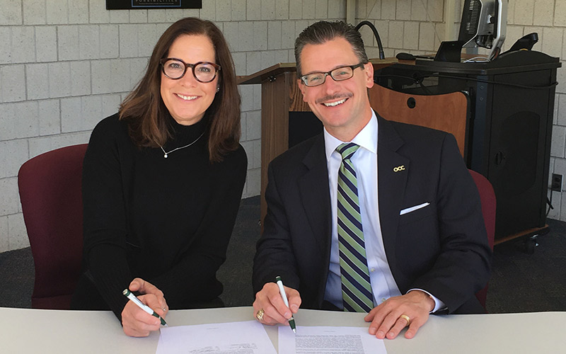 OCC Chancellor Peter Provenzano and Mary Hope McQuiston, Autodesk's VP of Education Experiences sign the agreement.